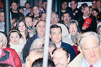 Texas senator and Republican presidential candidate Ted Cruz joins the crowd to say the Pledge of Allegiance at The Village Trestle restaurant in Goffstown, New Hampshire, on Wed., Feb. 3, 2016.