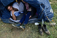 Pictured: A migrant couple in their tent Tuesday 01 March 2016<br />