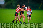 Stacks Emma McCarthy been tackled for possession by Siobhan Ni Chuannaigh and Neasa Ni Luing of Corcha Duibhne in the Kerry Ladies Intermediate Football Championship.