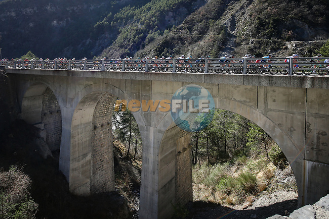The peloton on La Colmiane during Stage 7 of Paris-Nice 2021, running 119.2km from Le Broc to Valdeblore La Colmiane, France. 13th March 2021.<br /> Picture: ASO/Fabien Boukla | Cyclefile<br /> <br /> All photos usage must carry mandatory copyright credit (© Cyclefile | ASO/Fabien Boukla)