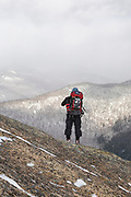 Hiker standing on the summit of Mount Crawford in Hadley's Purchase, New Hampshire USA.