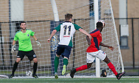Malden, Massachusetts - June 9, 2018:  In a National Premier Soccer League (NPSL) match, Boston City FC (red/white) defeated Hartford City FC (white/green/blue), 2-0, at Brother Gilbert Stadium on Donovan Field.<br /> Missed PK foul.