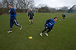 Tranmere Rovers Club Physiotherapist Les Parry, 10/03/2008. Prenton Park, League One. Dressed in his trademark shorts, Tranmere Rovers' club physio Les Parry oversees the rehabilitation of long-term injury victim, wingers Steve Davies (left) and Chris Shuker, at the club's training ground at Raby Mere. Les Parry has been the club physiotherapist since 1993 and recently completed 800 games with the club. At the time he was also working on completing his PhD at Liverpool John Moores University. Photo by Colin McPherson.