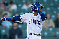 Round Rock Express outfielder Engel Beltre #7 follows through on his swing against the Omaha Storm Chasers in the Pacific Coast League baseball game on April 4, 2013 at the Dell Diamond in Round Rock, Texas. Round Rock defeated Omaha in their season opener 3-1. (Andrew Woolley/Four Seam Images).