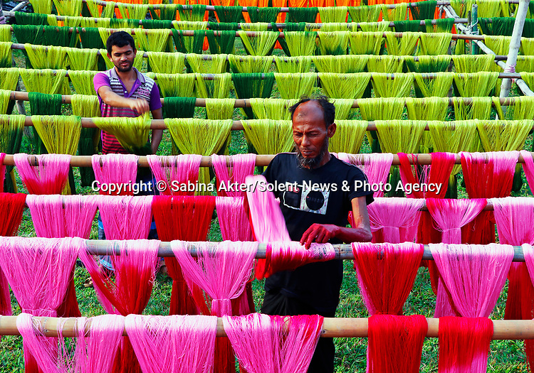 Thousands of colourfully dyed threads are hung up to dry across an area the size of a football field.  The vivid images come from the Narsingdi region of Bangladesh, an area heavily reliant on the textile industry.<br /> <br /> The photos were taken by keen amateur photographer Sabina Akter.  SEE OUR COPY FOR DETAILS.<br /> <br /> Please byline: Sabina Akter/Solent News<br /> <br /> © Sabina Akter/Solent News & Photo Agency<br /> UK +44 (0) 2380 458800