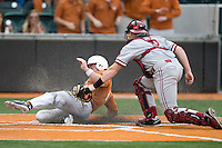 Texas 1B Tant Shepherd slides safely home against Stanford on March 4th, 2011 at UFCU Disch-Falk Field in Austin, Texas.  (Photo by Andrew Woolley / Four Seam Images)