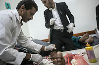 July 03, 2015 - Sana'a, Yemen: Civilians receive medical treatment in the Junhuria Hospital after a fighter jet from the Saudi-led coalition bombed the civilian neighborhood of Jaraf located in Zoubeiri area in the Yemeni capital of Sana'a. The neighborhood was bombed twice during an attemp to hit the house of the leader Houthi Brigadier Ali Al Nashri. The bombs missled the target killing many civilians, among the dead were one woman and two children. (Photo/Narciso Contreras)