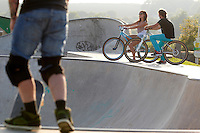 Clinton Johns on DMR jump bike , with girlfriend Georgina .  Hayle skatepark  , Cornwall .