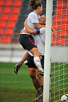 Abby Wambach and Lauren Cheney celebrate after connecting on the game winning goal.  The USA defeated Norway 2-1 at Olhao Stadium on February 26, 2010 at the Algarve Cup.