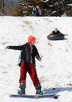 Noelle Wright, a sophomore at the University of Arkansas, cuts across a hill Thursday, February 18, 2021, on a snowboard at Kessler Mountain Regional Park in Fayetteville. The National Weather Service forecast for Friday is mostly sunny skies with a high near 37 degrees. Check out nwaonline.com/210219Daily/ and nwadg.com/photos for a photo gallery.<br /> (NWA Democrat-Gazette/David Gottschalk)