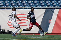 FOXBOROUGH, MA - JULY 25: USL League One (United Soccer League) match. Mayele Malango #10 of New England Revolution II dribbles down the wing as Illal Osumanu #28 of Union Omaha closes during a game between Union Omaha and New England Revolution II at Gillette Stadium on July 25, 2020 in Foxborough, Massachusetts.