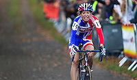 03 NOV 2012 - IPSWICH, GBR - Helen Wyman (GBR) of Great Britain recovers after winning the elite women's European Cyclo-Cross Championships in a time of 43 minutes and 52 seconds in Chantry Park, Ipswich, Suffolk, Great Britain after a sprint finish with Sanne van Paassen (NED) of the Netherlands .(PHOTO (C) 2012 NIGEL FARROW)