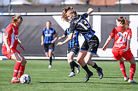 Aster Janssens (5) of Standard  pictured defending on Marie Minnaert (13) of Club Brugge during a female soccer game between Club Brugge Dames YLA and Standard Femina de Liege on the 17 th matchday of the 2020 - 2021 season of Belgian Scooore Womens Super League , saturday 20 March 2021  in Brugge , Belgium . PHOTO SPORTPIX.BE   SPP   DAVID CATRY