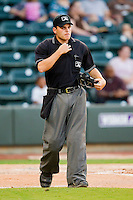 Home plate umpire Jansen Visconti between innings of the Carolina League game between the Potomac Nationals and the Winston-Salem Dash at BB&T Ballpark on June 13, 2012 in Winston-Salem, North Carolina.  The Dash defeated the Nationals 5-3.  (Brian Westerholt/Four Seam Images)