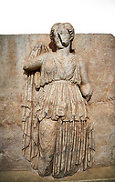Roman Sebasteion relief sculpture of Ethnos with belted peplos, Aphrodisias Museum, Aphrodisias, Turkey.   Against a white background.<br /> <br /> The matronly figure wears a belted classical dress (peplos) and held her long cloak up behind. The square hole above her shoulder with a corresponding hole in the back, was for lifting the finished relief into the ancient building by crane.