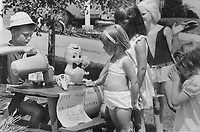 Business was Brisk yesterday for seven-year-old Hugh Spence; an enterprising businessman with a big heart. He knew that in this hot weather there had to be a big demand for refreshments among the kids in his neighborhood. So Hugh set up a cold drink stand in front of his Grisalda Cres. home in Scarborough and sold his cooling wares for two cents a glass. He also sold old toys and books. In two days Hugh took in $1.60 that will be given The Star Fresh Air Fund.<br /> <br /> Griffin, Doug<br /> Picture, 1968