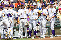 LSU Tigers team huddle before the NCAA College World Series game against the TCU Horned Frogs on June 14, 2015 at TD Ameritrade Park in Omaha, Nebraska. TCU defeated LSU 10-3. (Andrew Woolley/Four Seam Images)