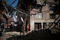 A woman stands in front of her house at Bhaktapur, near Kathmandu, Nepal. May 03, 2015