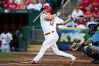 Stephen Piscotty (12) of the Springfield Cardinals follows through his swing after making contact on a pitch during a game against the Northwest Arkansas Naturals at Hammons Field on August 23, 2013 in Springfield, Missouri. (David Welker/Four Seam Images)