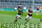Conor Hayes of Kerry tries to get inside of Galway's corner back Jack Glynn in the U20 All Ireland football semi final.