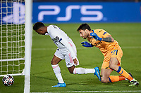 16th March 2021; Madrid, Spain;  Rodrygo Goes of Real Madrid goes past Marco Sportiello of Atalanta during the Champions League match, round of 16, between Real Madrid and Atalanta played at Alfredo Di Stefano Stadium