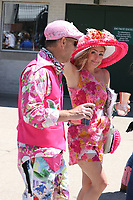 30th April 2021; Kentucky, USA;  Spectators dress in bright colors on during Oaks Day on April 30, 2021 at Churchill Downs in Louisville, Kentucky.