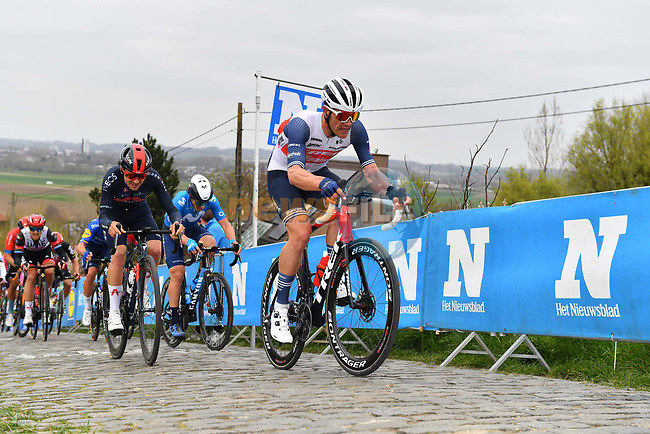 Jasper Stuyven (BEL) Trek-Segafredo and Tom Pidcock (ENG) Ineos Grenadiers climb the Paterberg during the 2021 Tour of Flanders running 254.3km from Antwerp to Oudenaarde, Belgium. 4th April 221.  <br /> Picture: Serge Waldbillig | Cyclefile<br /> <br /> All photos usage must carry mandatory copyright credit (© Cyclefile | Serge Waldbillig)