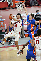 Arkansas forward Jaylin Williams (10) takes a shot Tuesday, Feb. 16, 2021, as Florida forward Colin Castleton (12) defends during the first half of play in Bud Walton Arena. Visit nwaonline.com/210217Daily/ for today's photo gallery. <br /> (NWA Democrat-Gazette/Andy Shupe)