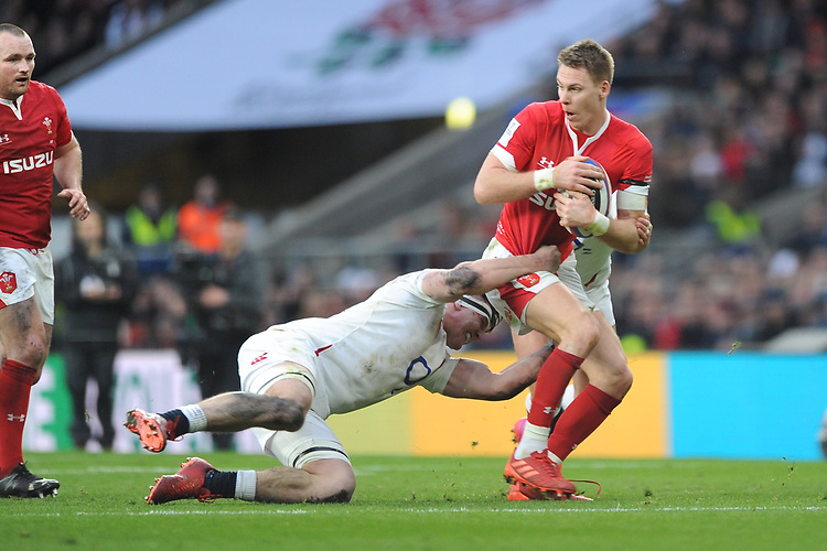 Liam Williams of Wales is tackled by Tom Curry of England  during the Guinness Six Nations match between England and Wales at Twickenham Stadium on Saturday 7th March 2020 (Photo by Rob Munro/Stewart Communications)