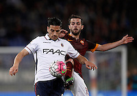 Calcio, Serie A: Roma vs Bologna. Roma, stadio Olimpico, 11 aprile 2016.<br /> Bologna's Sergio Floccari, left, and Roma's Miralem Pjanic fight for the ball during the Italian Serie A football match between Roma and Bologna at Rome's Olympic stadium, 11 April 2016.<br /> UPDATE IMAGES PRESS/Isabella Bonotto