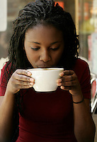 2005, Montreal Qc) CANADA<br /> Model Released photo<br /> a black woman drink coffee (cafe au lait)<br /> Photo : (c) 2005 Pierre Roussel