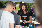 The owner of Bella Cakes works at the booth during the 20th Taste of Downtown, which is put on by the Advocates to End Domestic Violence, in Carson City, Nev., on Saturday June 15, 2013.<br /> (Photo by Kevin Clifford/Nevada Photo Source)