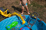 My son, two years old, likes to have all his toys in the wading pool with him.