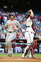 Jun. 2, 2011; Phoenix, AZ, USA; Washington Nationals shortstop Ian Desmond (6) crosses the plate to score in the first inning against the Arizona Diamondbacks at Chase Field. Mandatory Credit: Mark J. Rebilas-