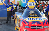 Jan 24, 2009; Chandler, AZ, USA; NHRA funny car driver Ron Capps is directed back to the starting line by crew chief Ed McCulloch during testing at the National Time Trials at Firebird International Raceway. Mandatory Credit: Mark J. Rebilas-