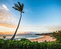 Beachgoers enjoy the sunset along the southern coast of Maui as seen from Wailea.