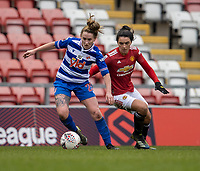 7th February 2021; Leigh Sports Village, Lancashire, England; Women's English Super League, Manchester United Women versus Reading Women; Rachel Rowe of Reading under pressure from Jessica Sigsworth of Manchester United Women