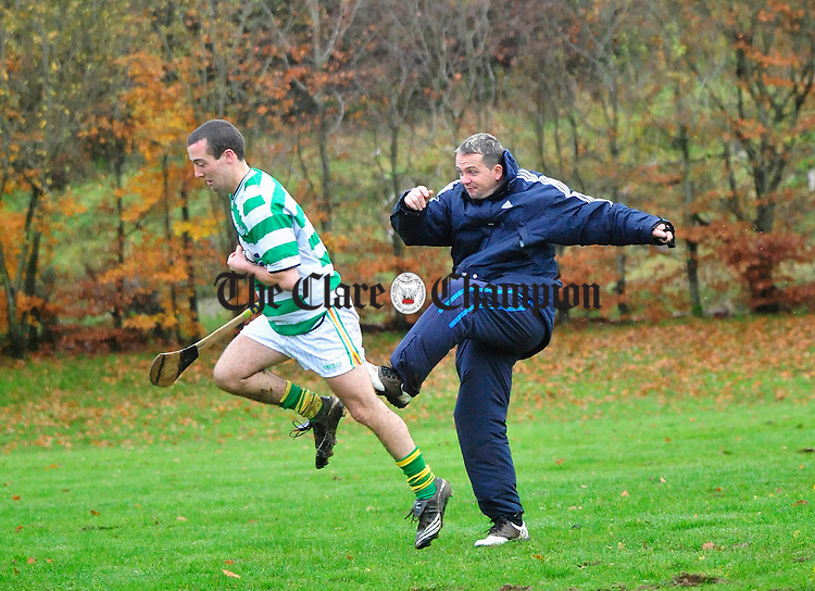 Davy Fitzgerald puts the broadford players through their paces during training. Photograph by Declan Monaghan
