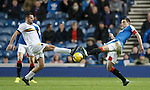 Garry fleming and Lee Wallace are mirror imagesof one another as they go for the ball