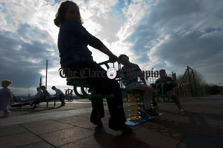 Local children enjoy a trial of the Patty Murphy Christenson memorial playground, which opens on Monday at Corofin. Photograph by John Kelly.