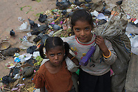 Young girls collecting garbage in Bhaktapur, Layaku Nepal