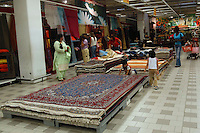 Supermercato Coop. Coop supermarket..Tappeti. Carpets..