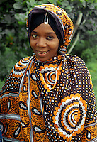 A young Zanzibari woman wearing the traditional.Khanga..Model Released.