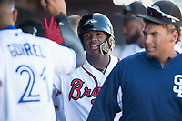 Peoria Javelinas right fielder Ronald Acuna (34), of the Atlanta Braves organization, is congratulated by teammates after scoring a run during a game against the Scottsdale Scorpions on October 19, 2017 at Peoria Stadium in Peoria, Arizona. The Scorpions defeated the Javelinas 13-7.  (Zachary Lucy/Four Seam Images)