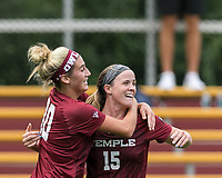 Newton, Massachusetts - September 9, 2018: NCAA Division I. Boston College (white) defeated Temple University (cherry), 4-1, at Newton Campus Soccer Field.<br /> Goal celebration.