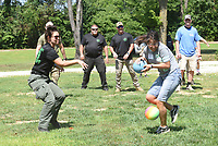 COPS AND KIDS SUMMER FUN<br />Lt. Mindy Nading (left) with the Benton County Sheriff's Office cuts loose with a throw during a dodge ball game on Tuesday July 13 2021 at the Cops and Kids Summer Games held at the Benton County Sheriff's Office in Bentonville. Deputies and staff hosted dozens of youngsters age 10-12 at the one-day summer games held outside the sherriff's office. Kids enjoyed an array of games and activities under the direction of the Benton County Police Athletic League. The athletic league aims to keep young people out of trouble by channeling their energy into recreational and athletic programs. Go to nwaonline.com/210714Daily/ to see more photos.<br />(NWA Democrat-Gazette/Flip Putthoff)