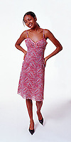 African American girl wearing paisley dress on white seamless<br />