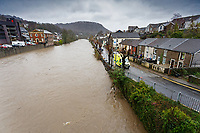 Pictured: The swollen river Taff by Sion Street in Pontypridd, Wales, UK. Sunday 16 February 2020<br /> Re: Storm Dennis has been affecting parts of Wales, UK.