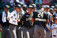 American team players - including Keenan Bell (32) - congratulate Will Benson (24) of The Westminster Schools in Atlanta, Georgia during the home run derby before the Under Armour All-American Game on August 15, 2015 at Wrigley Field in Chicago, Illinois. (Mike Janes/Four Seam Images)