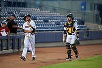 Peoria Javelinas starting pitcher Beau Sulser (26) and catcher Jason Delay (5), both of the Pittsburgh Pirates organization, walk toward the dugout before an Arizona Fall League game against the Surprise Saguaros on September 22, 2019 at Peoria Sports Complex in Peoria, Arizona. Surprise defeated Peoria 2-1. (Zachary Lucy/Four Seam Images)